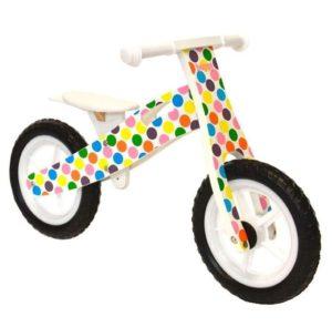 Bici sin pedales de madera con topos de colores
